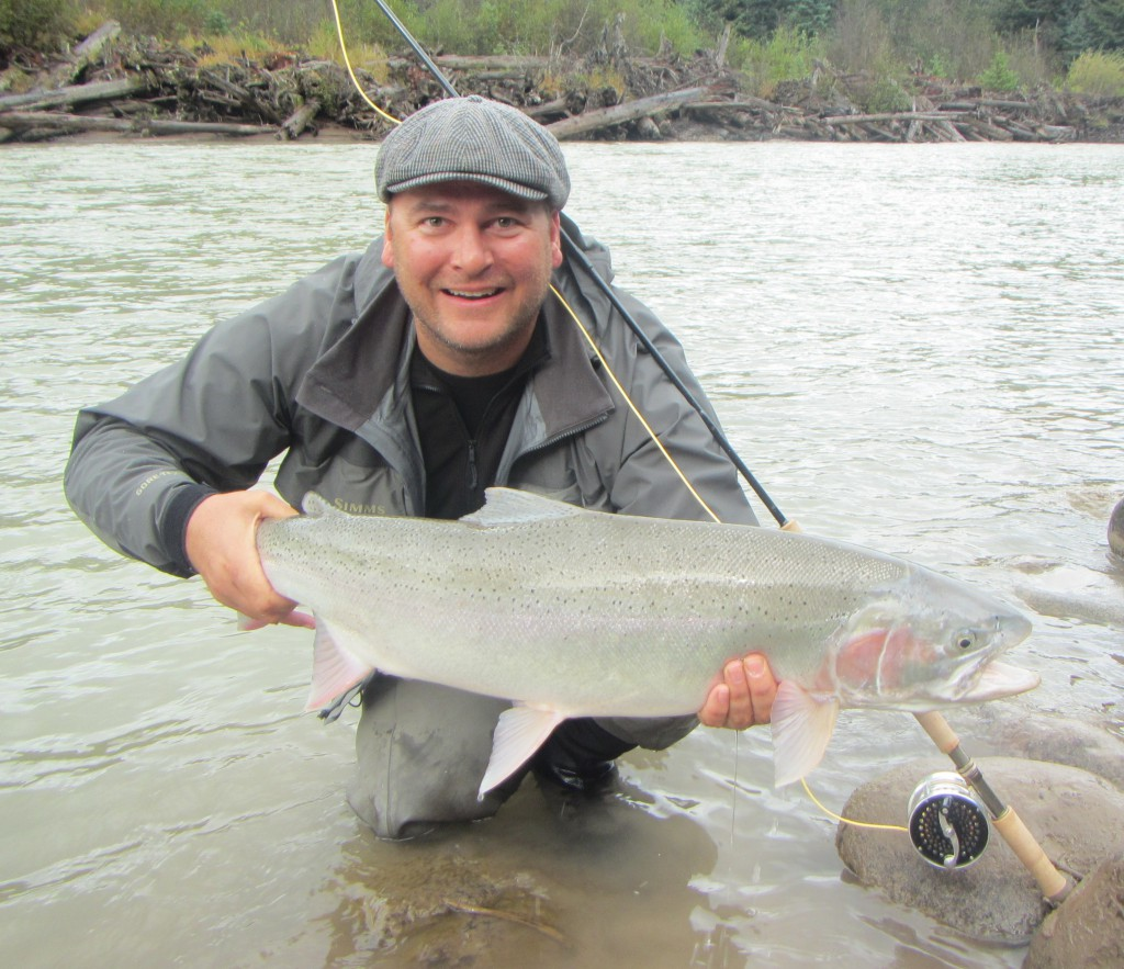 Gus with a nice steelhead on a trip with Nicholas Dean Lodge.