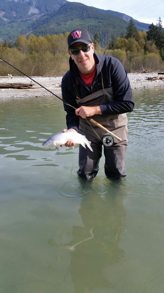 PA customer Noah with a rainbow successfully landed while nymphing salmon eggs on the Squamish.