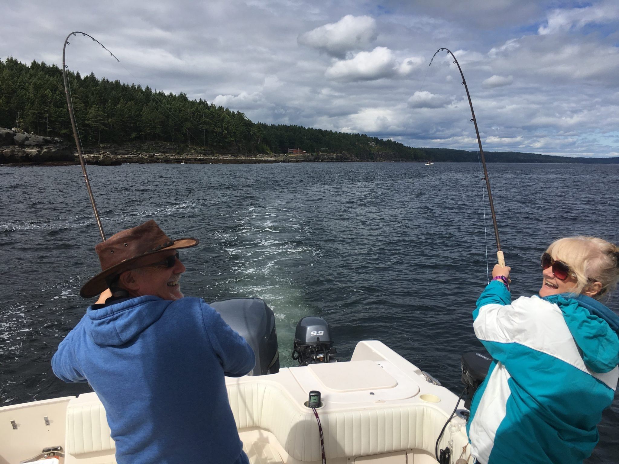Two salmon hooked at the same time in the salt water off Vancouver